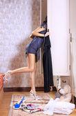Woman near sliding-door wardrobe — Stock Photo