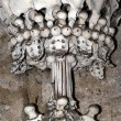 Sedlec Ossuary - column from human bones and skulls — Stock Photo