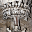 Stockfoto: Sedlec Ossuary - column from humbones and skulls