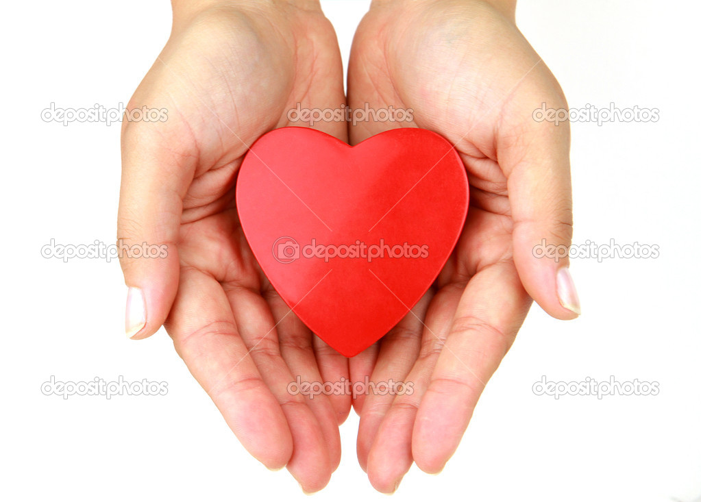 Heart in female hands - love and health symbol — Stock Photo #5588523