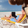 Woman with laptop on the beach — Stock Photo