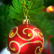 Bauble on Christmas tree — Stock Photo #6398203