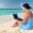 Woman with laptop at the sea — Stock Photo #6403323