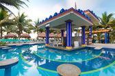 Bar at tropical swimming pool — Stock Photo