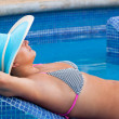 Relax at swimming pool bed — Stock Photo #6602679