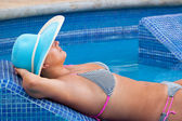 Relax at swimming pool bed — Stock Photo