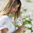 Handsome girl smells poppies — Stock Photo #6312846