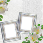 Lilies on white background with lace and 2 silver frames — Stok fotoğraf
