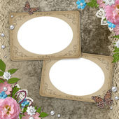 Vintage frames over grunge beige background with pink roses, pearls — Stock Photo