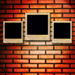 Three empty Blank photos on old brick wall — Stock Photo