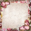 Stock Photo: Pink and purple vintage background with dried roses