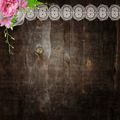 White lace and flowers on the wooden background — Stock Photo