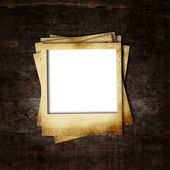 Old photo frame on wooden background — Stock Photo