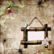 Vintage background with bamboo frame, orchids and butterfly — Stock Photo