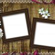Royalty-Free Stock Photo: Two wooden photo frames over grunge wood background