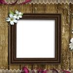 Wooden photo frame over grunge wood background — Stock Photo