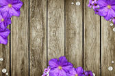 The grunge wood background with flowers — Stock Photo