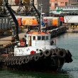 Stock Photo: Tug boat in port