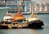 Three tug boats in the port — Stock Photo