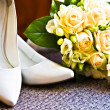 Royalty-Free Stock Photo: Wedding rings with bouquet and high heel shoes