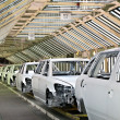 Stock Photo: Cars in row at car plant