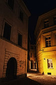 Illuminated mysterious narrow alley at night — Stock Photo
