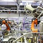 Robotic arms in a car factory — Stock Photo