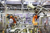 Robotic arms in a car factory — 图库照片