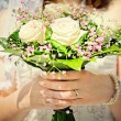 Bride holding her wedding bouquet — Stock Photo #6453847