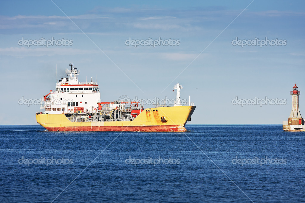 Large yellow and red tanker ship  entering the Gdynia Port - shipyard in Poland. Blue sea and sky in the background — Stock Photo #6517536