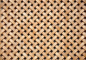 Wooden grid, the background of woven wood — Stock Photo