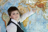 The boy is studying the physical map of the world — Stok fotoğraf