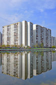 Residential apartment building, and reflection — Stock Photo