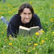 A man reads a book in the park - Stock Photo