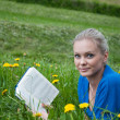 A girl student with a book in the park — Stock Photo