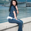 A beautiful young woman on the background of a ship — Stockfoto