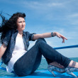 Royalty-Free Stock Photo: A beautiful young woman on a yacht at sea