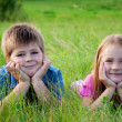 Stock Photo: Funny Boy and girl lying on grass