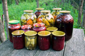 Home canning. Pickled vegetables and jam — Stock Photo