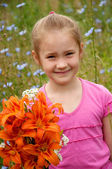Girl with a bouquet of orange lilies — Stock Photo