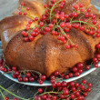 A delicious cake home with a red cherry - Foto de Stock
