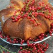 A delicious cake home with a red cherry - Stock Photo