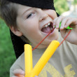A boy plays with a left-handed catapult — Stock Photo