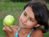 A beautiful girl with a delicious green apple — Stock Photo