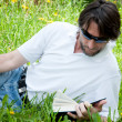 A man reads a book in the park — Stock Photo #6647931