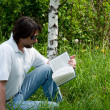 A man reads a book in the park — Stock Photo #6647939