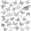 Set black white butterflies of a tattoo — Stock Vector #5537274