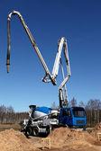A concrete pumper on the building site — Stock Photo