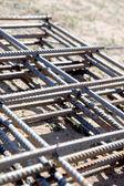 Concrete steel reinforcement.Detail of iron bars for building construction — Stock Photo