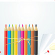 Set of colorful pencils on the convoluted paper — Stock Vector